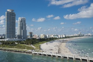 Miami Florida beach, waterway, and cityscape with tall buildings